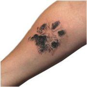 Hand paw tatoo